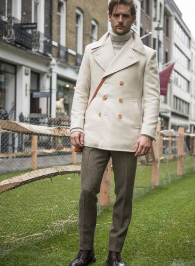 Model wearing off-white bespoke peacoat by Savile Row bespoke tailor Anderson & Sheppard