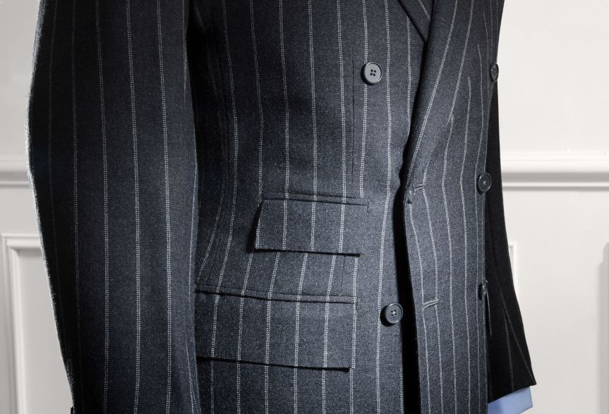 Double breasted chalk stripe jacket by Anderson & Sheppard: Pockets detail. Savile Row bespoke tailors