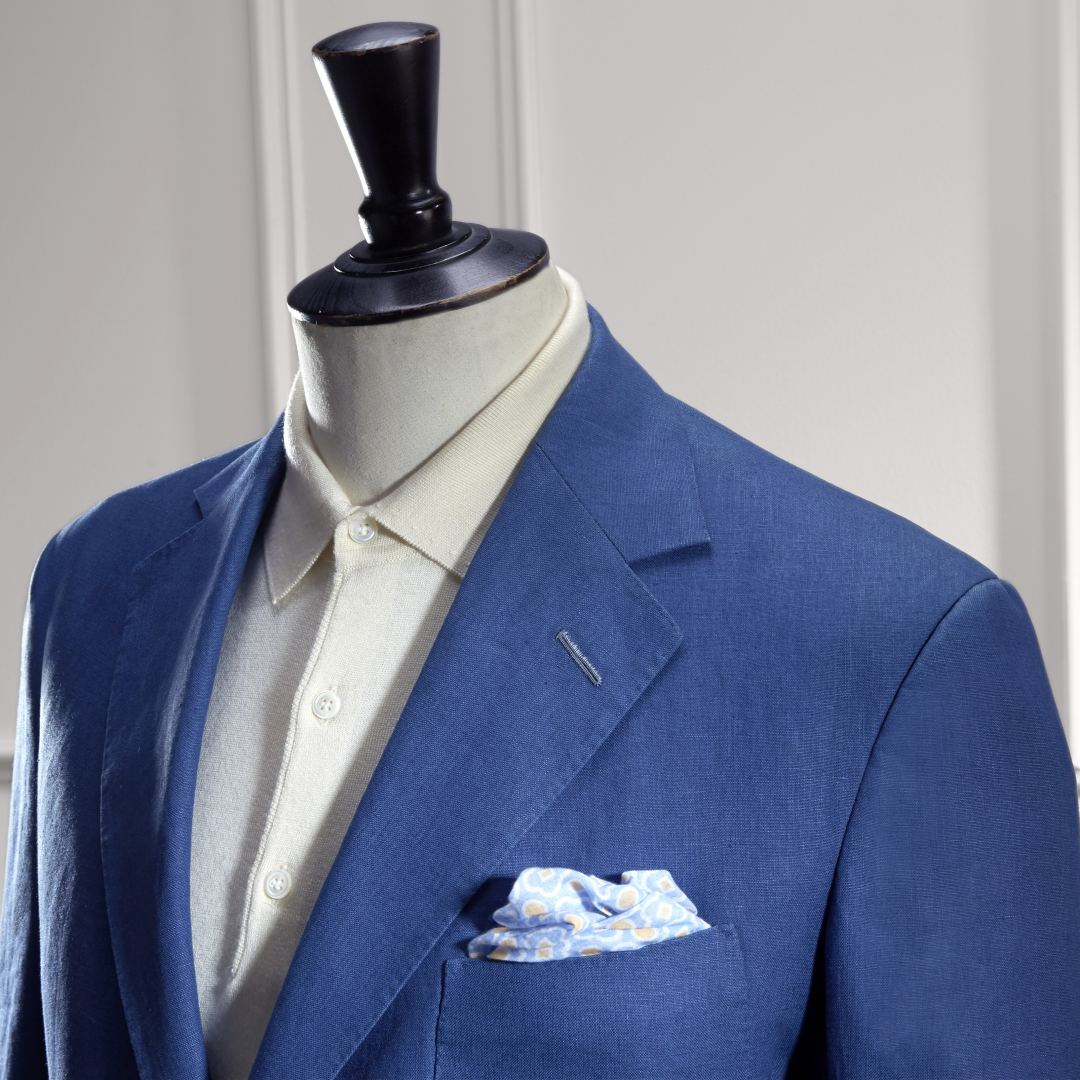 Single Breasted Mid Blue Linen Jacket with three button roll through, three patch pockets, side vents and horn buttons.