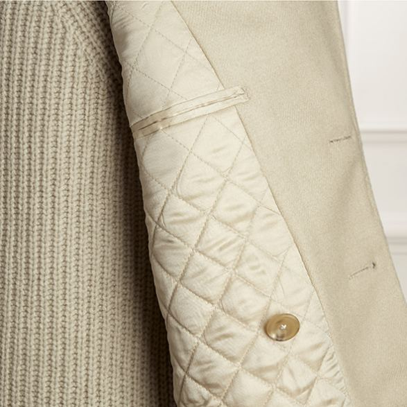 Anderson & Sheppard Bespoke Gallery Ivory Peacoat Lining Detail Tailors Savile Row