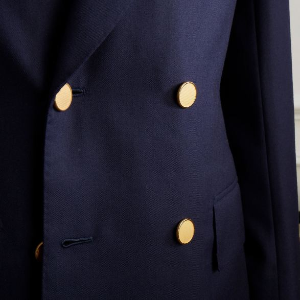 Double breasted navy blazer by Anderson & Sheppard: Brass buttons detail. Bespoke Savile Row tailors