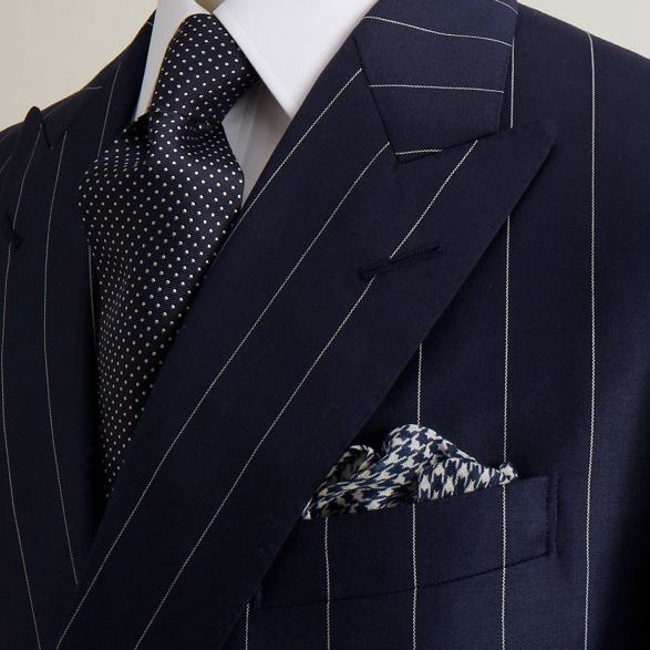 Navy double breasted jacket in pinstripe cloth by Anderson & Sheppard: Front detail. Savile row bespoke tailors