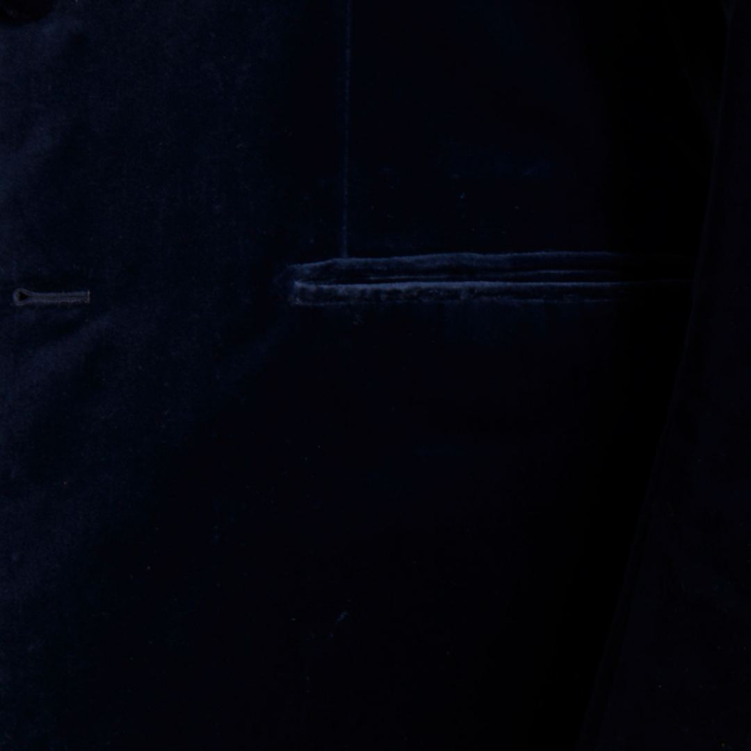 Single breasted jacket and trousers of navy blue velvet with 3 buttons. Jetted pockets, side vents and out ticket pocket.
