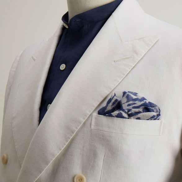 756f8b25bf104b White linen bespoke double breasted jacket by Anderson & Sheppard: lapel  and pocket detail. Collarless linen shirt