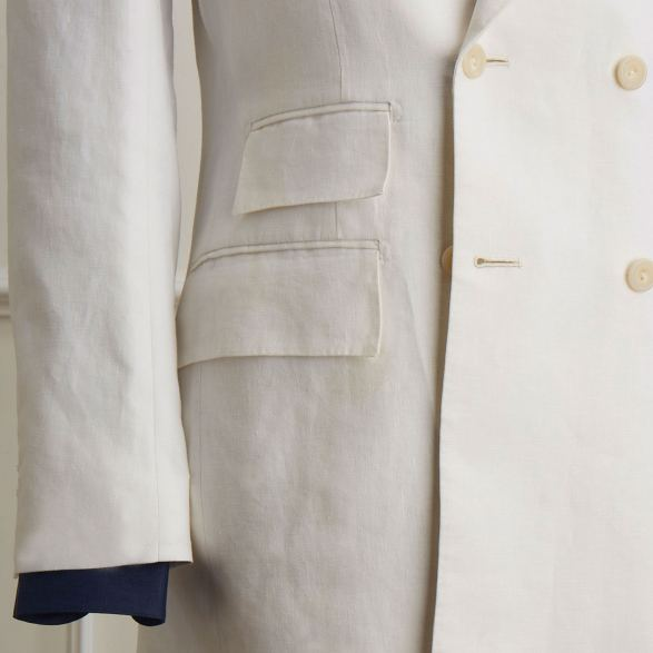 White linen bespoke double breasted jacket by Anderson & Sheppard: pocket and ticket pocket details.
