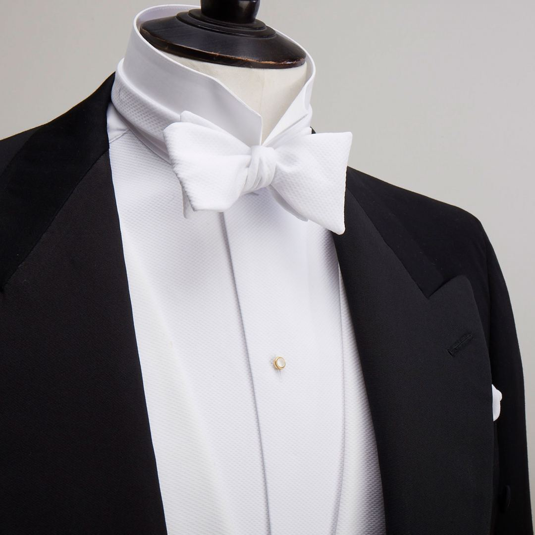 Dress shirt, collar, studs and white bow tie by Budd Shirtmakers.
