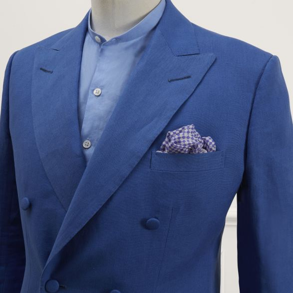 Double breasted linen jacket in china blue by Anderson & Sheppard: front detail. Bespoke Tailors from Savile row